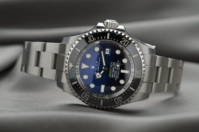 Rolex watch on desk