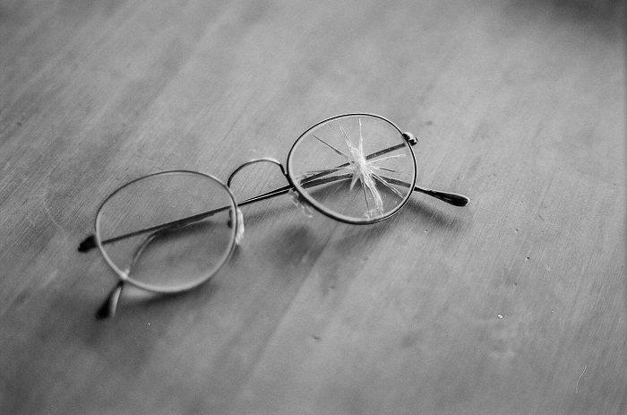 Damaged eyeglasses on table