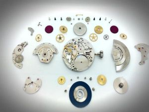 Watch pieces on white table